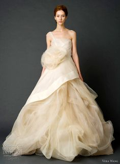 vera wang bridal spring 2012 - Sand one-shoulder garza and French tulle ballgown with asymmetrical peplum bodice and draped skirt with tulle petal detail and horsehair and tulle corsage.