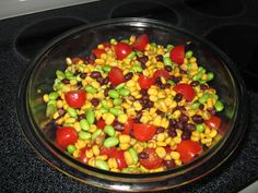 Summer Side Salad.  Black Beans, Corn, Edamame  and Tomatoes. Add any dressing for a quick and easy summer salad!