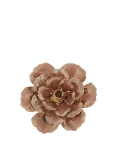 Accent ladylike looks with the romantic feel of Alexander McQueen's flower-shaped brooch.