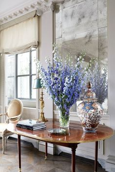 Delphiniums in a William Yeoward crystal vase and an Imari porcelain lidded jar top a Directoire mahogany table from Gerald Bland.