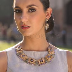 NEC/1/3711 Belli Necklace Set with Earrings in dull gold finish studded with amethyst, kundan, and peridot