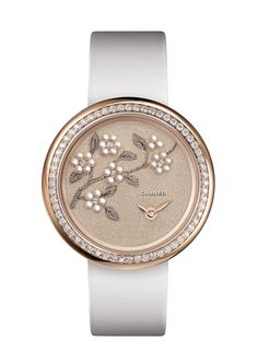 Can't take my eyes off this beautiful embroidered watch by Chanel.  Mademoiselle_Prive_Embroidered_Camellia_FB
