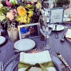 Each table had several framed photos taken in the locations of the table name and included pictures of the guests sitting at that table. - @weddingtidbits- #webstagram