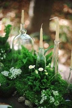 moss and greenery table runner with bell jars and candles