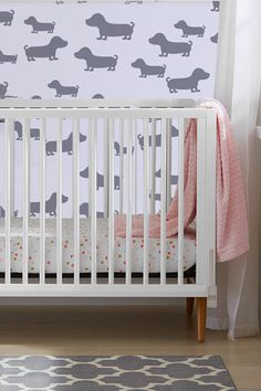 With chic, mid-century modern lines, the Roscoe crib is the perfect addition to any nursery. The crib easily converts into a toddler bed or day bed, and has three mattress height positions. Hand-crafted construction and stylish design are accented Puppy Nursery, Girl Nursery, Cool Dog Houses, Convertible Crib, Nursery Furniture, Cribs, Mattress, Mid-century Modern, Stencils