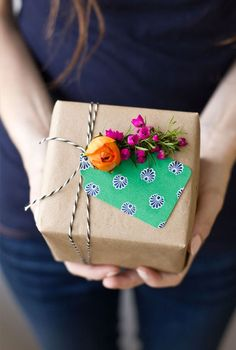 Present your holiday gifts with a fresh flower gift topper.