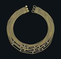 CARTIER A GOLD AND DIAMOND 'DRAPERIE' NECKLACE, Composed of ten strand of gold beads enhanced by fifteen brilliant-cut diamond bead collets, shortest row 36.5 cm Signed Cartier, no. 822203