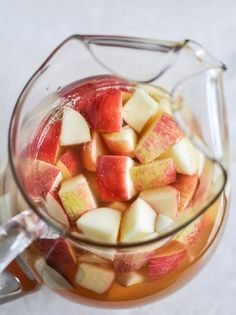Fall Sangria!! My tweak: 1 Large bottle of pinot grigio or whatever white wine you prefer, 2 1/2 cups fresh apple cider, 1 cup Sprite, 1/2 cup ginger brandy, 3 honey crisp apples, chopped, 3 granny smith apples, chopped, 3 pears, chopped, 1 can of mandarin oranges, and 3-4 cinnamon sticks