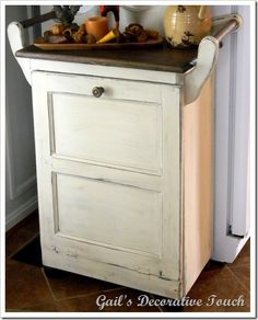How to hide the kitchen garbage can.  This is cool, I want one of these