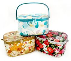 Baskets - Oval shape Assorted fabrics and colors Color-coordinated handle, trim and lining Cord-wrapped handle Magnetic snap closure Pocket and pin cushion attached on inside lid Includes lift-out tray for organizing small sewing supplies 14-1/4 in x 10-1/4 in x 8-1/8 in (36.19 cm x 26.03 cm x 20.63 cm)