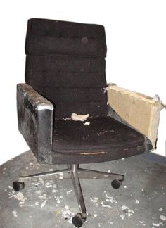 These chairs were made in the 1960s. This one had the original black vinyl (not leather) and black wool hopsack. The latex foam was dry and crunchy, the vinyl was mildewed, and the arms were patched with a lot of duct tape.