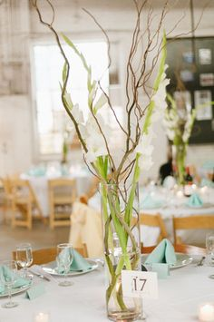 "We will also have some gladiolas and curly willow in the tall 24"" pilsner (fluted) centerpieces"