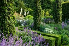I typically love structured gardens but holy smokes the property of British landscape designer ...