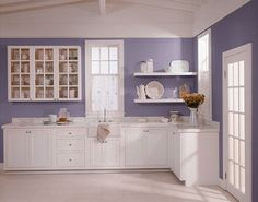 Photo from theentertaininghouse.com<br />I would call this one traditional verging on transitional. I love the asymmetry of the glass front cabinets and open shelves. That aspect is more contemporary but the cottage style of the cabinets and ceiling treatment are leaning more towards the traditional.The lavender here is not as much of a commitment as it's on the walls only.
