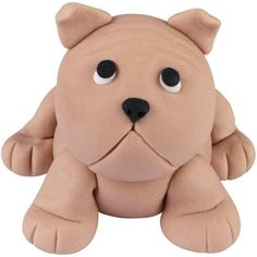 Animal lovers will roll over when they see Benny the English Bulldog edible topper. Modeled from Wilton's Shape-N-Amaze edible decorating dough, place this puppy on cakes and treats for birthday parties or other animal-theme celebrations.