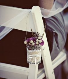 Another fun mason jar idea ~ Hang them off of Command Hooks that are on the chair.
