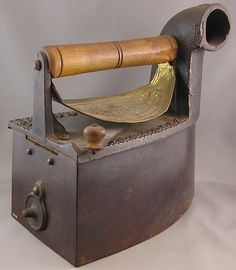 1870's charcoal iron for pressing clothes. (I've never heard of a charcoal iron. What a great idea!)