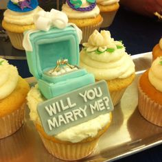 Great Way to porpose! Bring her in for cup cakes & have them put this right up front! (The box is made of fondant!)