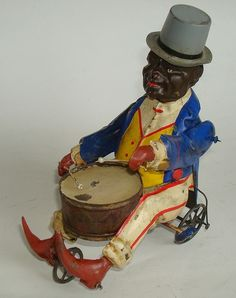 "1900 Günthermann ""Black man on Tricycle with Drum"""
