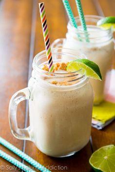 Cool and creamy key lime pie milkshakes are the perfect blend of creamy vanilla frozen yogurt, tart key lime, and graham cracker crumbs!