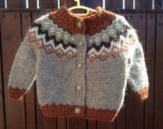 Handmade knitted sweater made from 2 strands of Icelandic wool. 100% Icelandic wool, very warm and cozy. Shipping via registered airmail. Size Chest 66