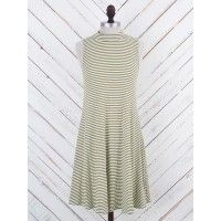 "We love the mod style of this dress and the comfortable fit and fabric it offers. We suggest adding slip on sandals, a floppy hat, and a long necklace to complete the look.   Sleek Fit   33"" Length   Sleeveless   Slip On</"