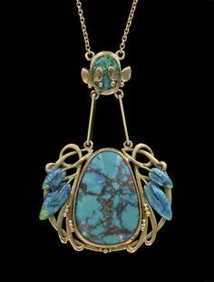 This is not contemporary - image from a gallery of vintage and/or antique objects. ARCHIBALD KNOX 1864-1933  Liberty & Co Pendant  Gold Enamel Turquoise