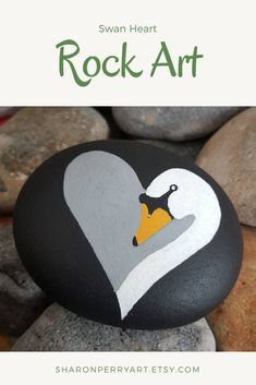 Excited to share the latest addition to my shop: Swan Heart Stone … NEW IN! Excited to share the latest addition to my shop: Swan Heart Stone Art with Black Background Rock Painting Patterns, Rock Painting Ideas Easy, Rock Painting Designs, Swan Painting, Pebble Painting, Pebble Art, Painting On Stones, Painted Rocks Craft, Hand Painted Rocks