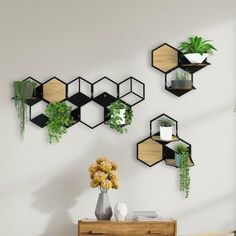 This listing is for a wall mounted planter made of steel and wood. The modular design of it allows you to combine as many as plant holders together. You can even change the holder shelves' places.- You may choose 3 to 6 holder shelves to use with 1 large holder body.- If you buy small planter body, it has 2 holder shelves.- Every shelf comes with a wooden base. You can use the shelf with or without wooden base.- You may change the places of the shelves on the body easily.- You may hang the wall Indoor Plant Hangers, Indoor Plant Wall, Plant Wall Decor, Wall Decor Design, Vertical Plant Wall, Indoor Plant Shelves, Metal Plant Hangers, Hanging Plant Wall, Hanging Terrarium