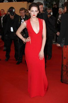 Kristen Stewart poses on the red carpet in 2012 at the Cannes Film Festival. Kristen Stewart was red hot in this Reem Acra gown.