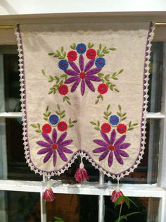 Vintage embroidered curtains in our kitchen.