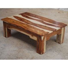 After a hard day on the range relax with a cup of coffee or a cold beer with our Dallas Ranch Contemporary Vandana Coffee Table. This classic living room table is made of solid Indian Rosewood, a top quality hard wood. The accent table has square legs and plank board table top design.