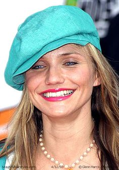 Cameron Diaz in Long Straight Hair with Big Cute Bright Cyan Hat  Blue-eyed blonde Cameron Diaz has a big smile as she wears a big bright cyan hat over her long blonde straight hair with bright fuschia lipstick and pearls in a fun modern look.