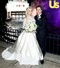 Holly Madison donned a custom-designed Greg Barnes wedding gown plus a $500,000 diamond tiara crafted by Alan Friedman.