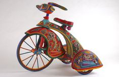 "Beaded Bike  Kathy and Tom Wegman, ""Using over 450 different colors of seed beads to transform everyday objects into works of art. They glue individual strings of beads to other people's discarded objects. Their general policy is ""the brighter, the better."" ~ source of narrative is their website"