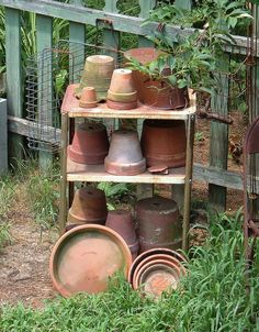 Garden...old and aged clay pots...worn green picket fence.