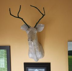 DIY: BOOK-WRAPPED TROPHY MOUNT... I would like to make this with the butt hanging on the other side of the wall.