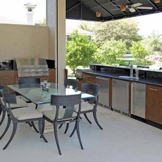 This U-Shaped outdoor kitchen featured stainless steel cabinets by ...
