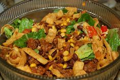 Frito Taco Salad  8-10 c lettuce, chopped, whatever looks like enough  3/4lb-1lb of gr turkey or beef  pkg taco seasoning  1 can black or pinto beans, drained  1 c corn  2 tomatoes, chopped  1.5 c shredded cheese  2 c Fritos  Catalina Dressing   (chopped green onions or black olives)  Brown ground meat, add taco seasoning. Remove from heat & drain.  Add beans & corn to meat, mix well. In large bowl, mix everything together.   We serve separately and build our own.