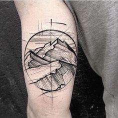 tatouage voyage homme de style dotwork sur le bras