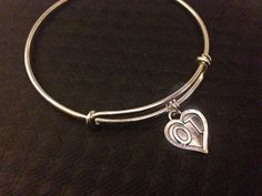 This can be sent directly to your intended with your personal message included. OT ~ Occupational Therapist Silver Plated Charm and attached to a silver pla Trendy Jewelry, Jewelry Accessories, Occupational Therapy Gifts, Bangles Making, Bangle Bracelets With Charms, Silver Charms, Christmas Time, Fun Stuff, Jewerly