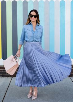 Mansur Gavriel Sun Bag Blue Satin Pleated Midi Skirt with t-strap nude pointed toe heels, and a blue chambray denim button front shirt for a surprising combo. Add a blush pink satchel purse for contrast. Shades of blue on blue date night outfit for women. Blue Skirt Outfits, Pleated Skirt Outfit, Dress Skirt, Colourful Outfits, Colorful Fashion, Blazer Rose, Satin Pleated Skirt, Look Fashion, Fashion Outfits