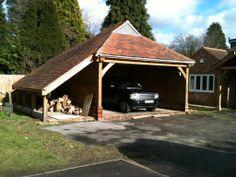 Oak frame garage and wood store. Crown Oak Development, 01489 571513 and 07932 655379
