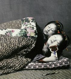 Warmer to sleep together.  Hand-colored photo, 1870's, Japan, by photographer  Felice Beato