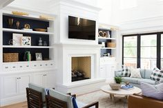 How to style a room when it's painted bright white! Mid century vibes in a living room designed by Studio Mcgee contemporarylamps Home Living Room, Living Room Designs, Living Room Decor, Living Spaces, Brick Fireplace, Fireplace Design, White Fireplace, Fireplace Furniture, Fireplace Moulding