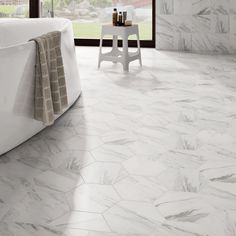 The SomerTile 8.625x9.875-inch Marmol Hex Porcelain Floor and Wall Tile provides a hexagon shape with a marbleized pattern. Meant to resemble Carrara marble, these tiles offer a timeless feel.
