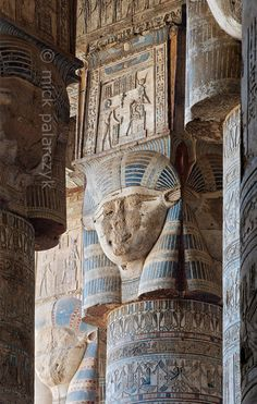 """[EGYPT 29516]<br /> 'Hathor headed columns in Dendera.'<br /> <br /> The columns in the outer hypostyle hall (or pronaos) of the Hathor Temple at Dendera are crowned by four-sided capitals carved with the face of the cow-eared goddess. The faces symbolize the four cardinal points of the universe and stress the universal character of the sky goddess Hathor, who was also called """"Lady with the four Faces"""".<br /> The square structure that is placed on top of the actual face is a sistrum, a…"""