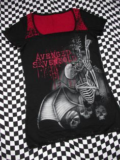 my first band shirt I ever got was this one except it was just a tee shirt but now I have the back of it cut down the spine and the thing but yeah still my favorite shirt