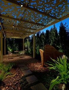 This shade arbor, located in The Woodlands, TX north of Houston, spans the entire length of the back yard. It combines a number of elements with custom