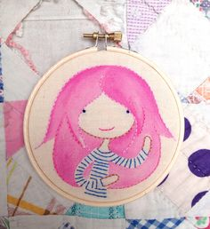 """I embroidered this Kawaii style, Pink Hair Hipster on canvas in a 4"""" hoop.  I painted part of the hair with acrylic paint mixed with fabric medium.  You can see more of my work at http://www.etsy.com/uk/shop/SendAmyBellOver"""